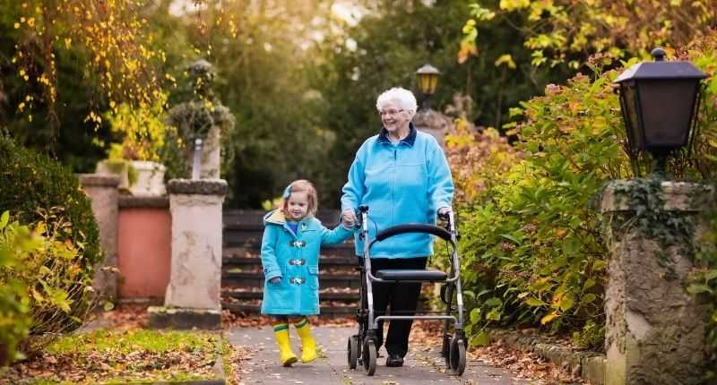walking with a mobility aid rollator outdoors